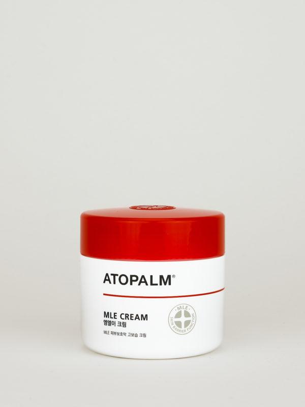 ATOPALM MLE Cream. Koreanische Gesichtscreme für empfindliche Haut in weißer Dose mit schwarzer Aufschrift und knall rotem Deckel.