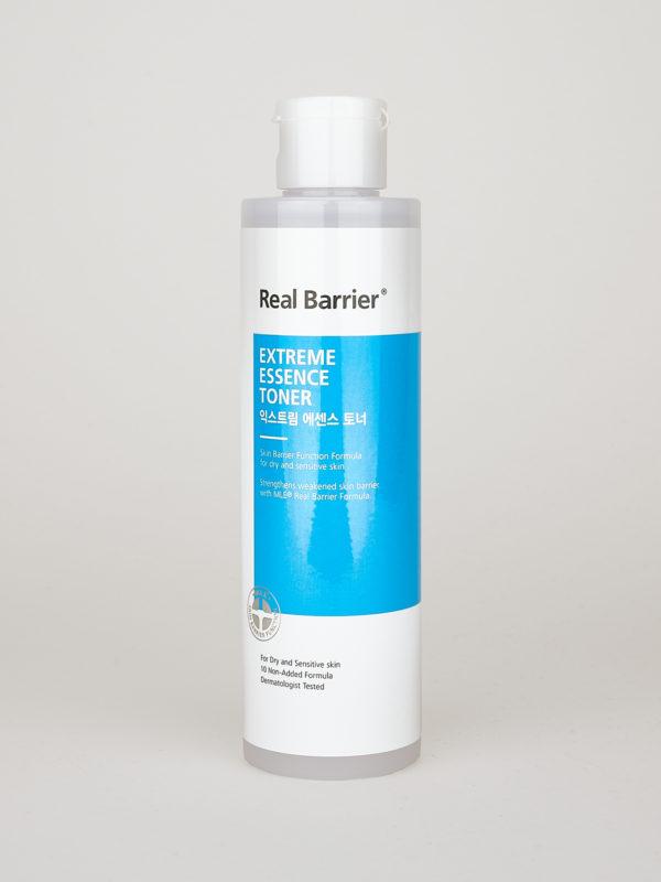 Real Barrier Extreme Essence Toner. Ein Cream Skin Toner in einer weiß blauer Flasche mit weißem Klapp Deckel.